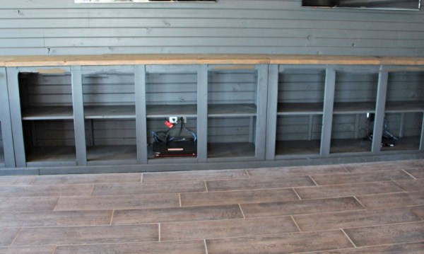 DIY Man Cave Ideas: Barn Door entertainment console to store all the TV equipment by Diva of DIY on Remodelaholic.