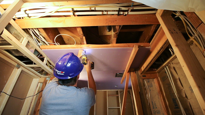 Installing Water-Resistant Bathroom Drywall and Cement Board for Tile Walls in a Jack-and-Jill Basement Bathroom @Remodelaholic