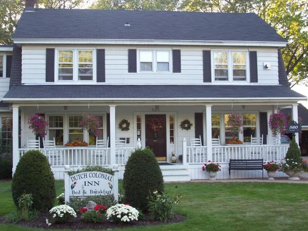 Dutch Colonial Inn | Colonial Porch Curb Appeal Ideas and Inspiration (with columns and railing)
