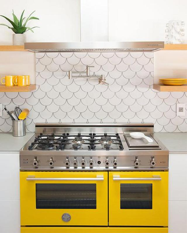 Yellow Kitchen Stove and Accents via Gia Renovations | Yellow Kitchen Inspiration #Remodelaholic