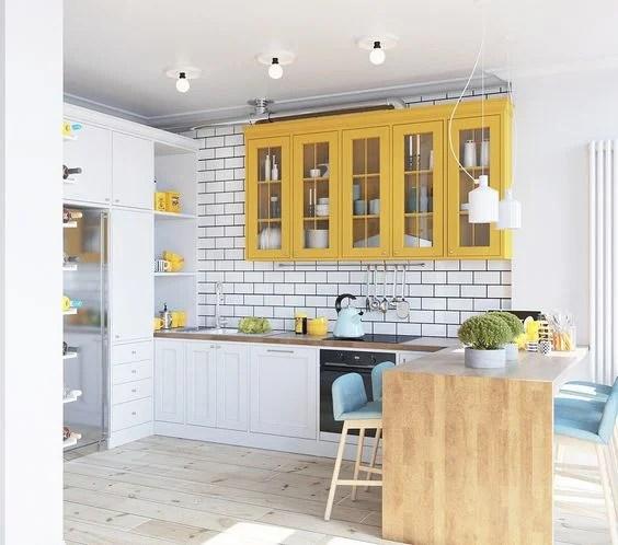 Modern white and yellow kitchen via Home Designing | Yellow Kitchen Inspiration #Remodelaholic