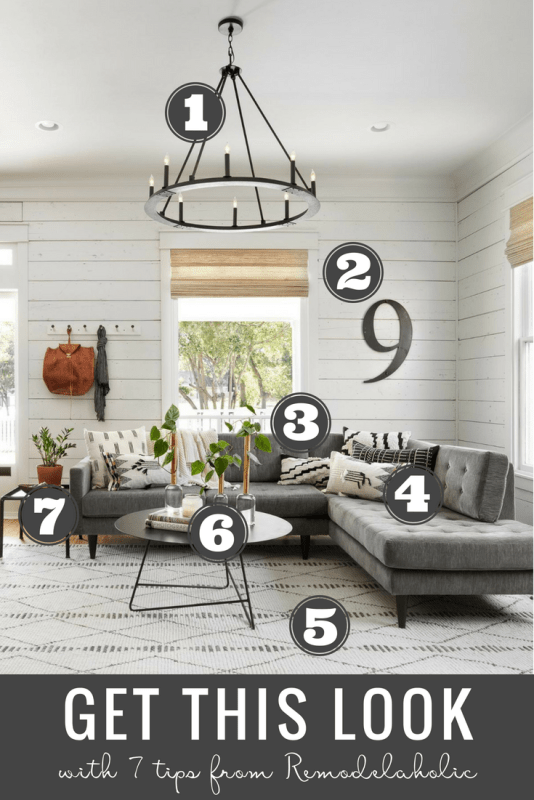Get This Look: Fixer Upper Living Room from The Americana House | Recreate the iconic Joanna Gaines modern farmhouse chic style from the shiplap and neutral area rug to the chandelier and mid-century sofa with these tips, decorating picks, and DIY tutorials #getthislook #remodelaholic #fixerupper #modernfarmhouseGet This Look: Fixer Upper Living Room from The Americana House | Recreate the iconic Joanna Gaines modern farmhouse chic style from the shiplap and neutral area rug to the chandelier and mid-century sofa with these tips, decorating picks, and DIY tutorials #getthislook #remodelaholic #fixerupper #modernfarmhouse
