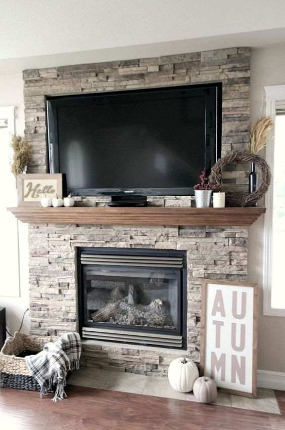 Ideas for Decorating Around a TV Over the Fireplace Mantel, stone mantel with decor via Love Create Celebrate