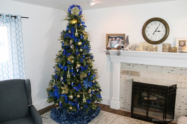 Decorate a gold and blue dollar store Christmas tree for under $50 -- plus 3 easy tricks for saving money while decorating your Christmas tree. #remodelaholic #Christmastree #dollarstoreChristmas #Christmashacks