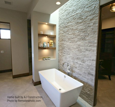 Bathtub With Stone Wall, Floating Shelves, And Skylight AJ Construction (97).ed
