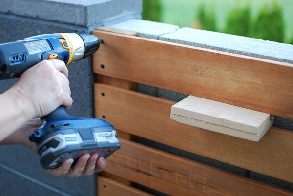 How to Install a DIY Wood Slat Garden Wall With Planters Tutorial, The Garden Glove Featured On Remodelaholic