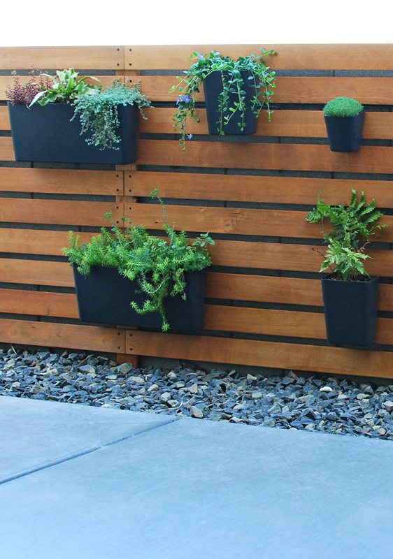 Diy Wood Slat Planter Wall Over Concrete Block Fence, The Garden Glove Featured On Remodelaholic
