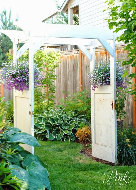 Garden Arbor Made With Vintage White Doors, Flowers Hanging Where Windows Used To Be