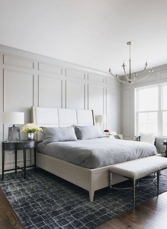 Grey Textured Walls With White Bed, Grey Sheets And Wooden Side Tables