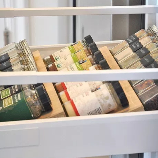 Kitchen Drawer Pulled Out To Display Rows Of Spice Jars, Easy Access, Easy Readability