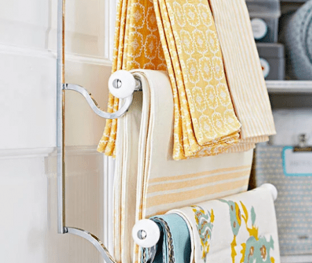 Towel Bars On Linen Closet Doors With Bright Yellow, Blue And White Pieces Draped Over