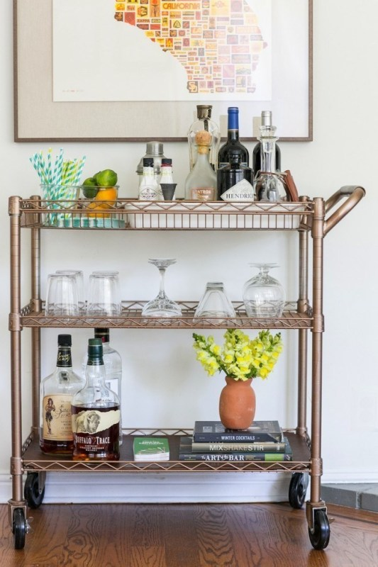 Metal Bar Cart With Drinks, Glasses, Books, Straws, Fruit And Flowers In Vase