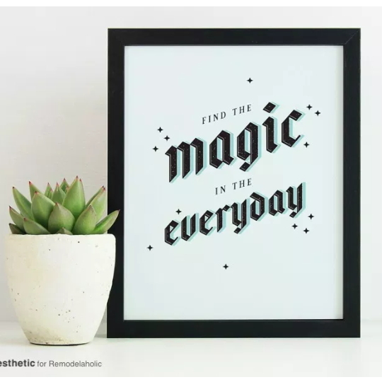 Black Frame With White Print And Black Wording Saying Find The Magic In The Everyday