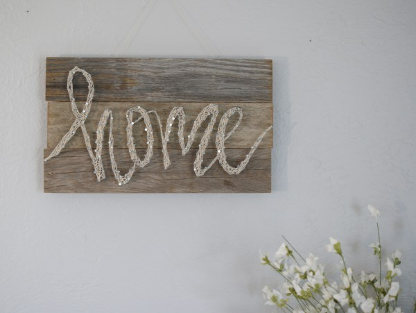 Thread Art, 3 Pieces Of Wood Creating A Rectangle With Nails And Thread Spelling The Word Home