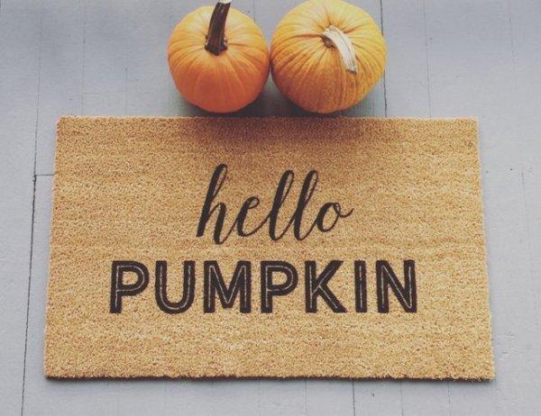 Two Small Orange Pumpkins With Hello Pumpkin Door Mat