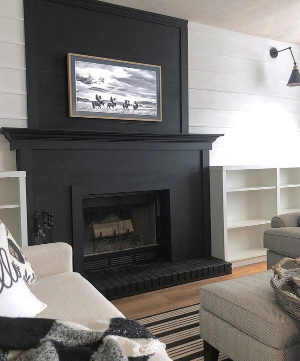 Black Fireplace With White Planked Walls And Built In Shelves