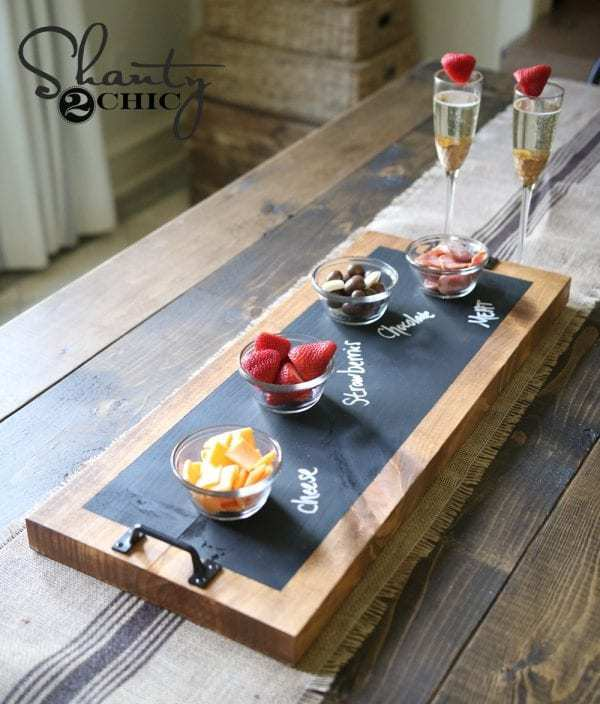 Wood Table With Burlap Table Runner And Wood Serving Tray With Chalkboard Top Where You Can Label Food Being Served