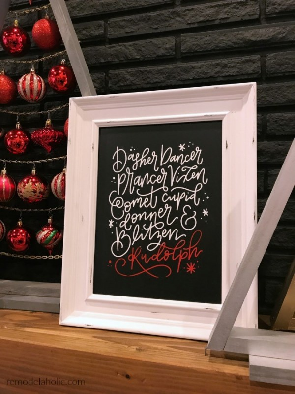White Frame With Black Background And White Caligraphy Of Reindeer Names