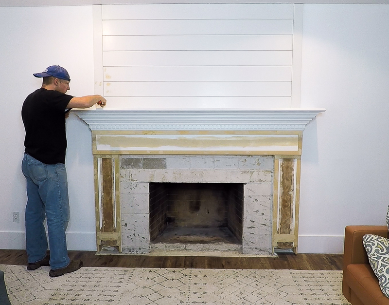 updated shiplap woodwork around an existing fireplace mantel and surround