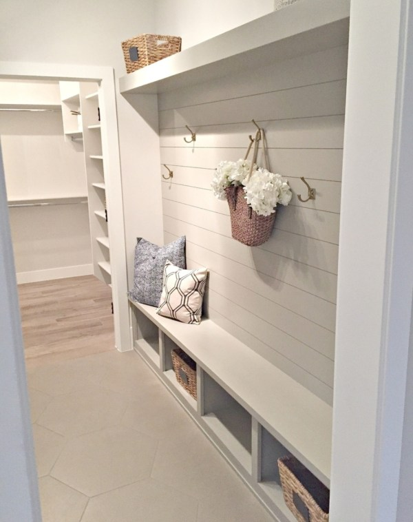 Gorgeous Grey And White Mudroom Area With Shiplap Wall, Hooks, Cubbles, A Bench And Shelf