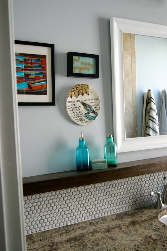 Bathroom Vanity With Penny Tile Backsplash And Floaring Shelf