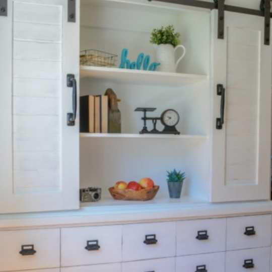 Built In Shelves With Cupboard And Sliding Cupboard Doors