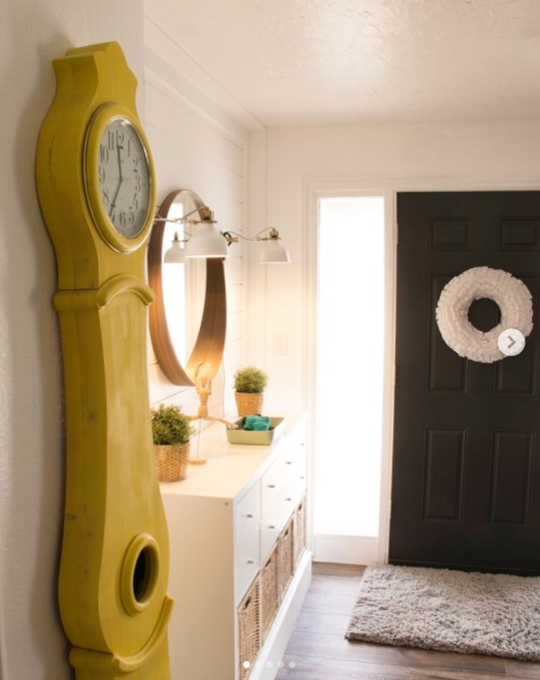 Entryway Full Of Color, Yellow Clock, Black Door, Gold Circle Mirror, White Drawers With Wicker Baskets