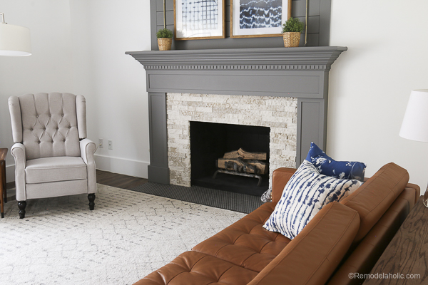 Beautiful and neutral tribal print area rug in the living room. DIY Fireplacce Makeover Fireplace Mantel Airstone Remodelaholic.com