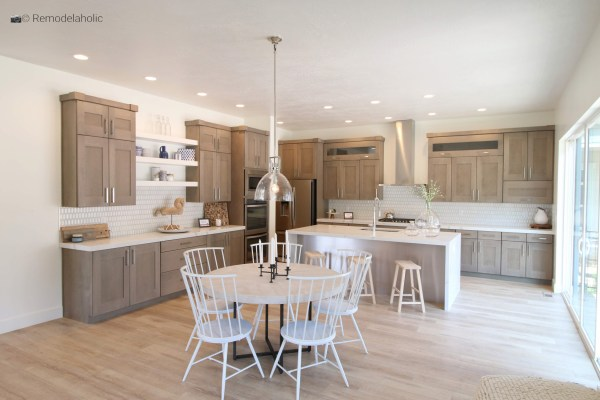 Gorgeous white spindle chairs in a neutral wood tone kitchen, SLPH 2018 Home 5 Regal Homes, photo by Remodelaholic