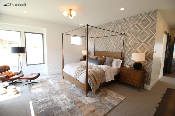 Master bedroom with geometric or aztec wallpaper feature wall, SLPH 2018 Home 14 Magleby Communities, Photo by Remodelaholic