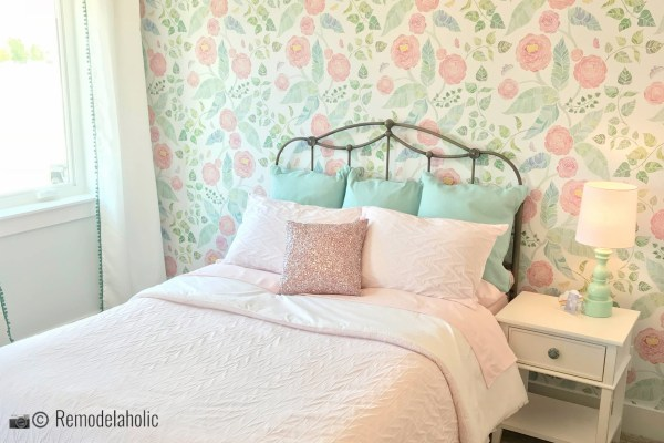 A simple metal headboard pairs perfectly with a fun floral wallpaper, UVPH 2018 Home 8 Greentech Construction, Design Hintz Interior Desi, Photo by Remodelaholic