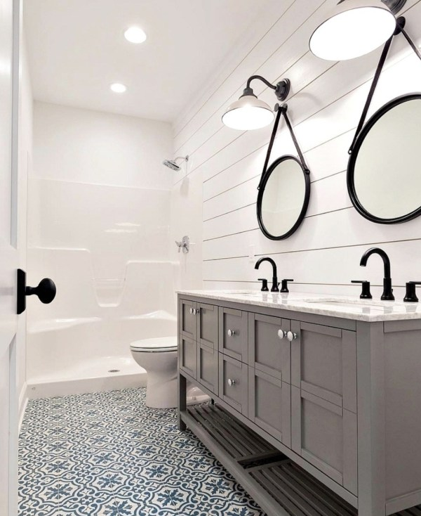 Bathroom With Shiplap White Walls, Beautiful Blue Tiled Floor And Gorgeous Double Sink Vanity With Two Circle Hanging Mirrors