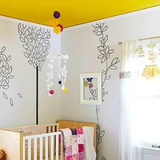 Mustard Nursery With Wood Crib, White Walls With Leaf Art And Mustard Yellow Ceiling