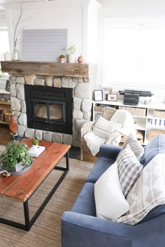 Reclaimed Wood Coffee Table By Rock Fireplace And Blue Sofa