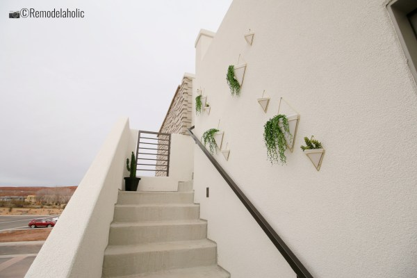 Hanging Planters Wall for outdoor decor, SGPH 2019 House 03 Cole West Resorts LLC, Photo by Remodelaholic