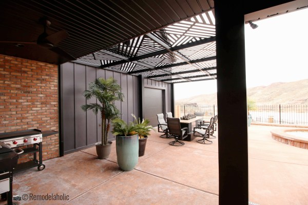Pergola over an outdoor dining area. SGPH 2019 House 04 Interstate Homes, Photo by Remodelaholic