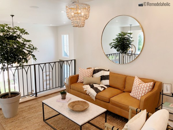 Ways to style a sofa! UVPH 2018 Home 31 Raykon Construction, White + Gold Design, photo by Remodelaholic