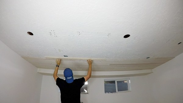 Installing Whitewashed Knotty Pine Boards On Ceiling for a Basement Plank Ceiling