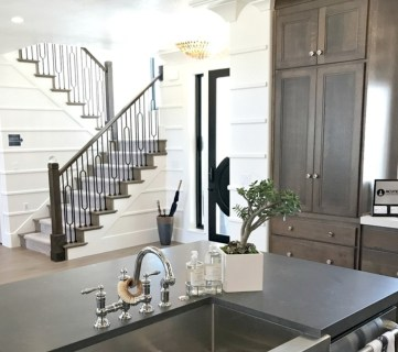 View Through Kitchen To Stairs, White Walls, Wood Cabinets, Stainless Steel