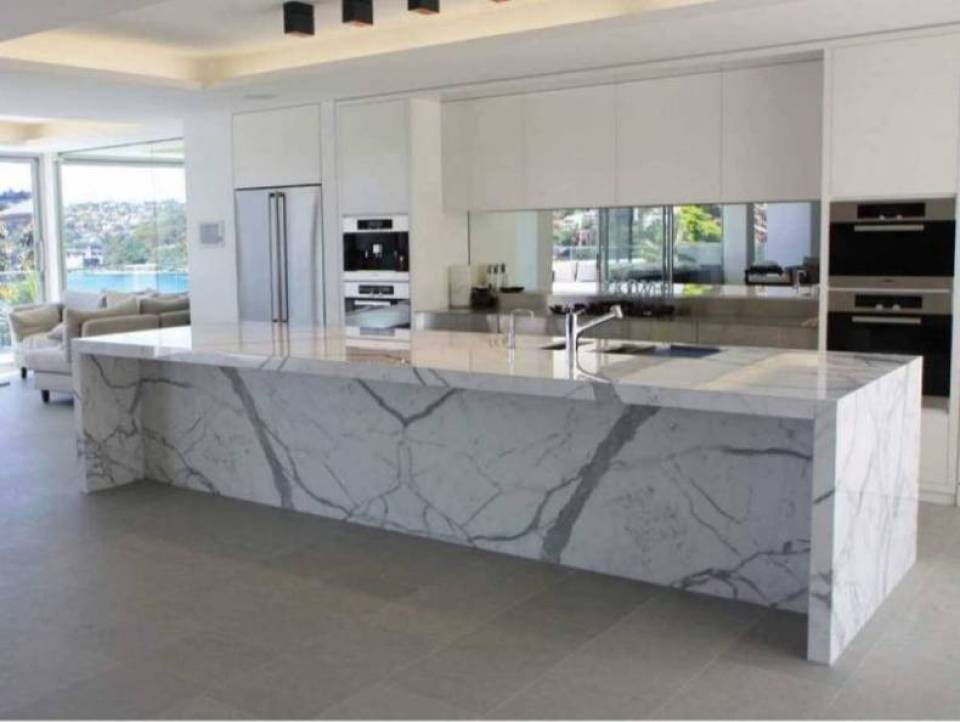 Calcutta Marble Countertops in a Modern White Kitchen