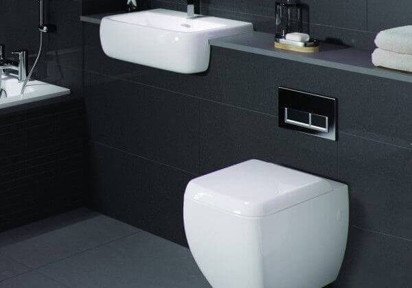 Floating toilet and sink in a small bathroom
