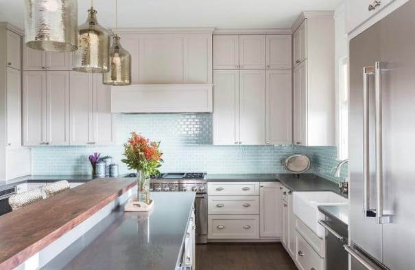 Subway Tile Glass Backsplash in a transitional white kitchen