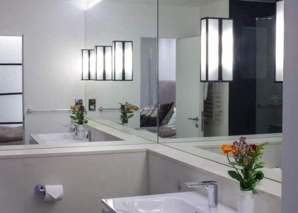 oversized mirror in tiny bathroom