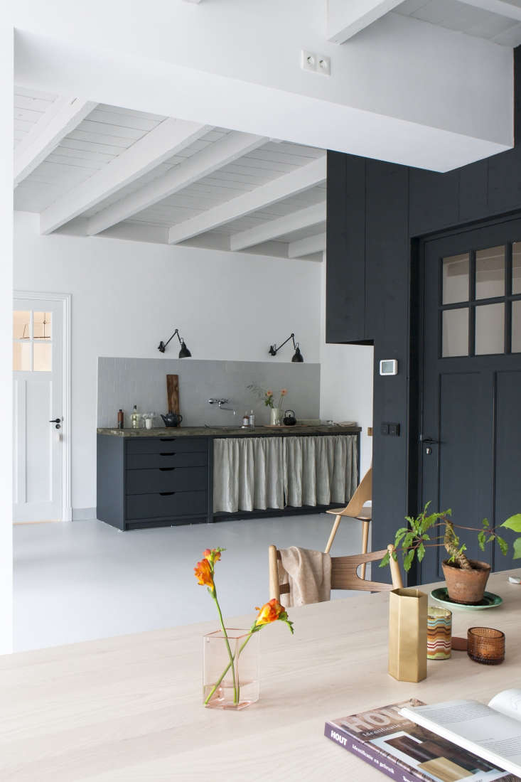 Christen-Starkenburg Interieur-Plus workspace/curtained kitchen at Jan de Jong, a design shop in Friesland, the Netherlands | Remodelista