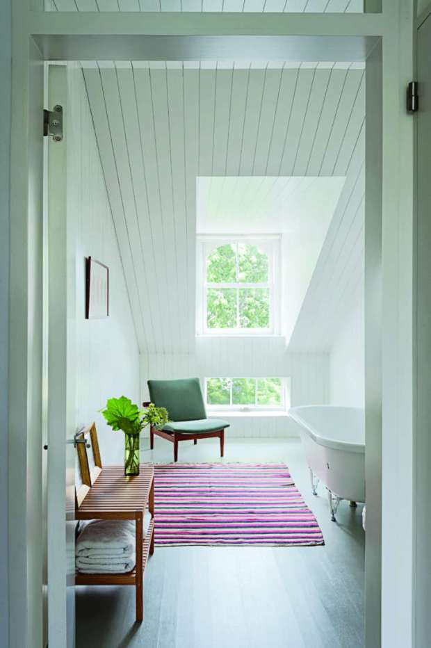 Not just for cozy charm: shiplap in a clean-lined, sparse bath in Nordic Beauty: A Brooklyn Townhouse Reinvented with Style—and Restraint.