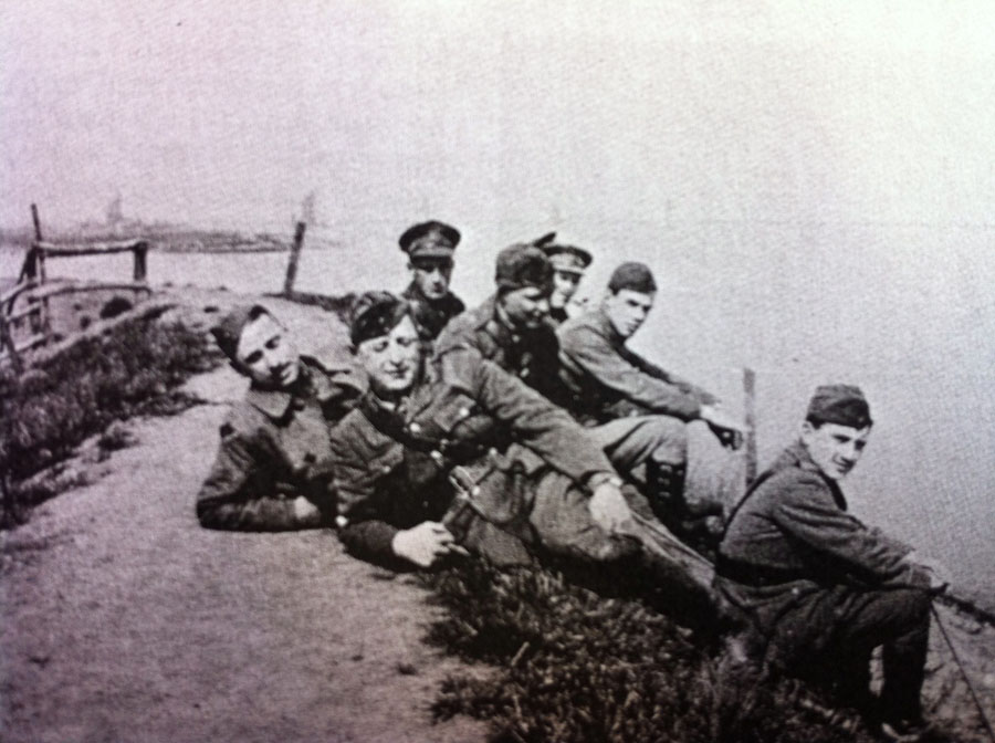 Air crew of 63 Squadron relax by the Thames at Joyce Green airfield in 1917.