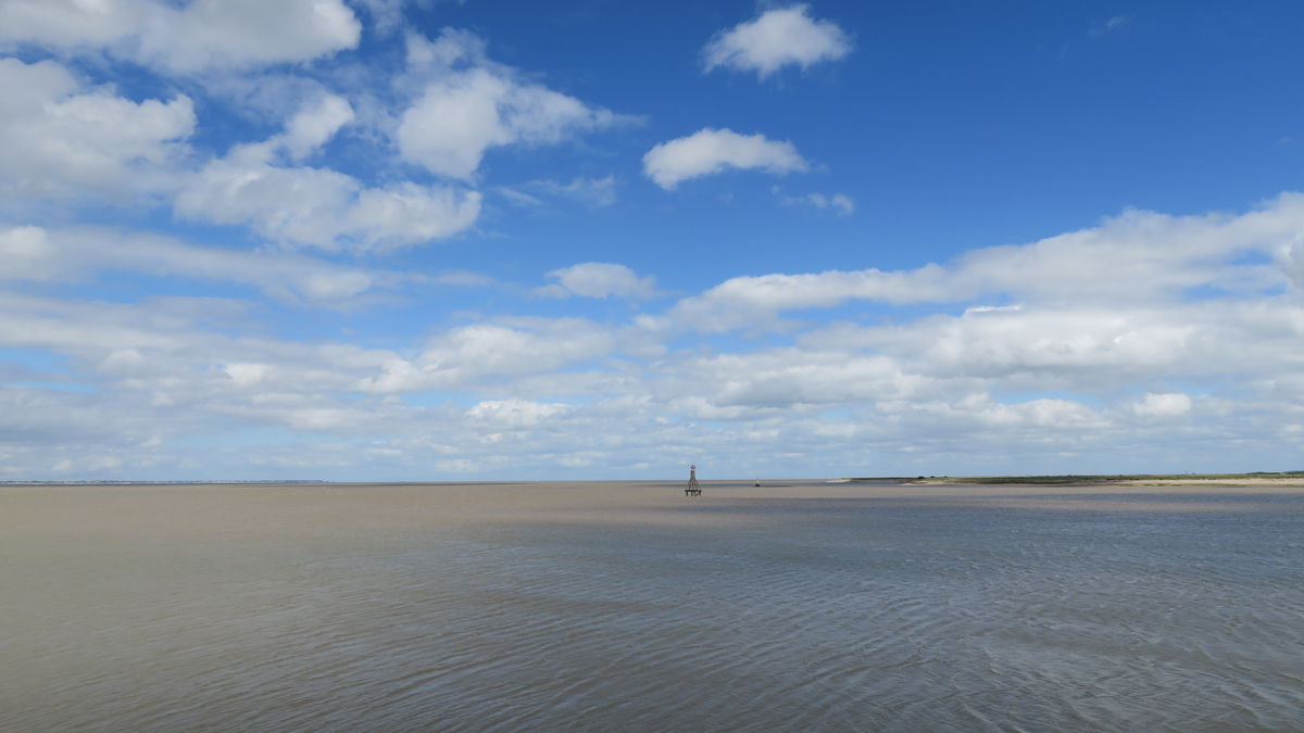 The Thames Estuary off Yantlet Creek. The London Stone is a mere speck beyond the navigational marker.