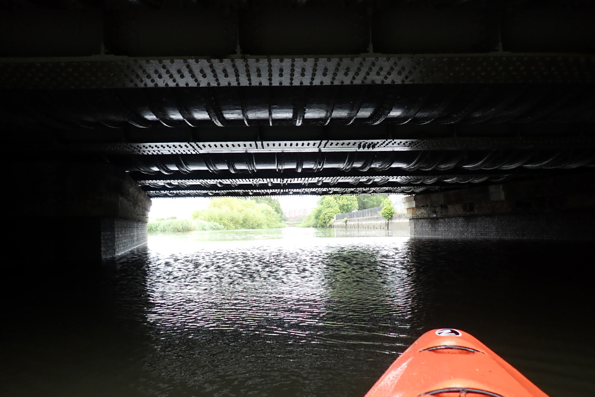 Kayaking under large pipes