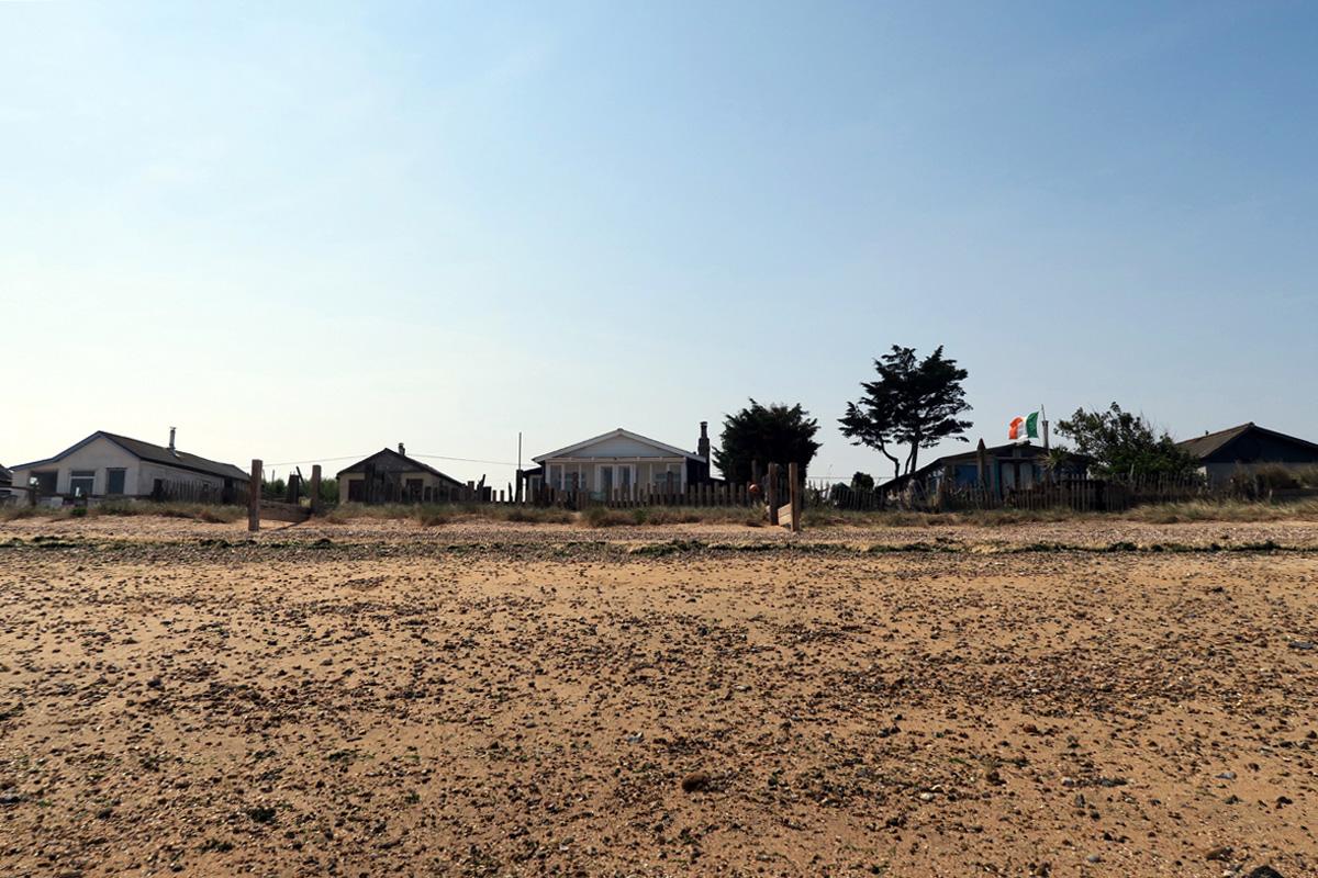 Wooden shacks overlooking Shellness Beach