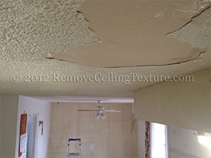 Leaky Roof Causes Ceiling Cracks And Delamination In